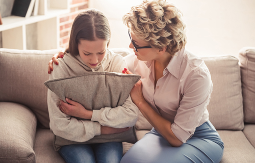 young girl with counselor in home